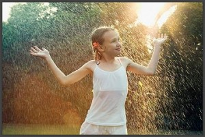girl-enjoying-rain