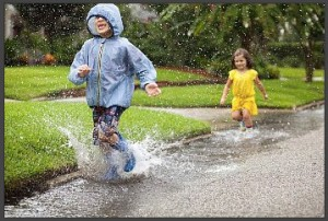 kids-playing-in-rain-water