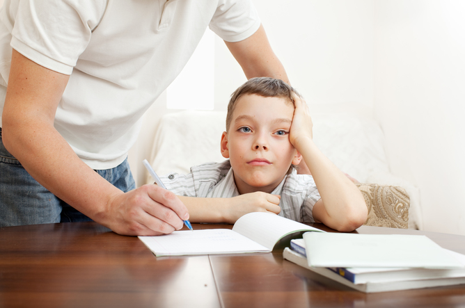 parent helping kid doing homework