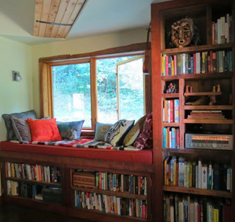 natural-light-streaming-window-surrounded-by-books