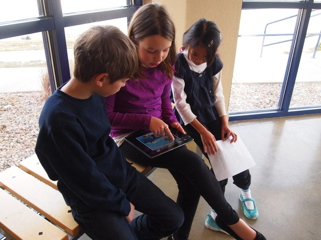 Kids with iPad learning Math