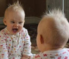 Funny-baby-looks-in-the-mirror