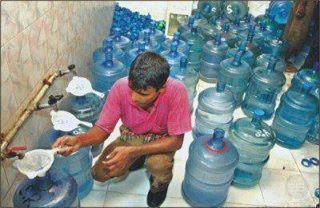 Funny Photo - Distilled Water Factory