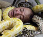 Amazing man with snakes